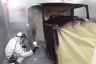 Spray painting in Dalby Paint Booth